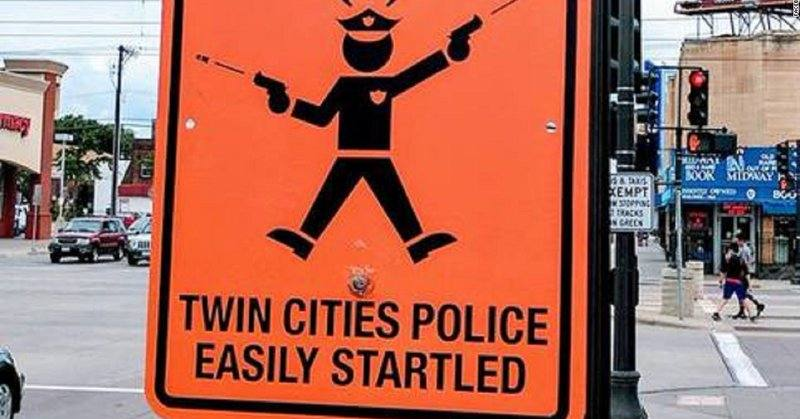 Street signs warning of 'easily startled' police posted around Twin Cities